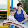Mother with toddler on slide — Stock Photo
