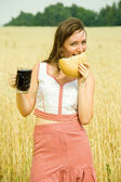 Girl with quass and bread — Stock Photo