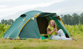 Camping happy woman front of tent — Stock Photo