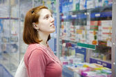 Woman in pharmacy drugstore — Stock Photo