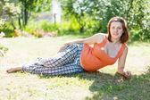 Pregnant woman on grass — Stock Photo