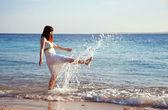 Happy woman at sea coast — Stock Photo