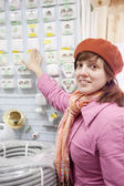 Woman chooses switch in electrical store — Stock Photo
