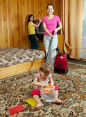 Family cleans in living room — Stock Photo