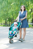 Mother with stroller — Stock fotografie