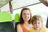 Mother and child traveling in autobus, — Stock Photo