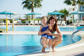 Happy mother with toddler at resort — Stock Photo