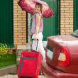 Woman with suitcase — Stock Photo #12502781