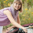 Woman trying to fix the car — Stock Photo #12502790