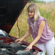 Woman with her broken car — Stock Photo