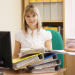 Stock Photo: Businesswoman with documents working in office