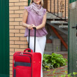 Happy woman with suitcase — Stock Photo #12502968