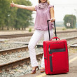 Woman waiting train on railroad — Stock Photo #12502976