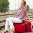 Woman with luggage waiting train — Stock Photo #12502984