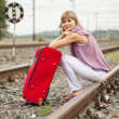 Woman sitting on rail — Stock Photo #12503009