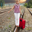 Happy woman walking on rail — Stock Photo #12503020