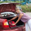 Blonde woman packing her baggage — Stock Photo