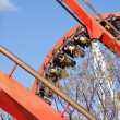Red roller coaster at Port Aventura park, Spain — Stock Photo #12505375