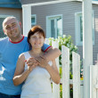 Happy couple in front of his residence — Stock Photo