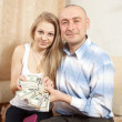 Happy family with many US dollars — Stock Photo