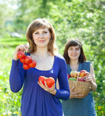 Happy women with harvest — Stock Photo