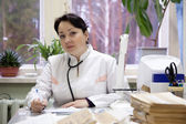 Doctor in clinic interior — Stock Photo