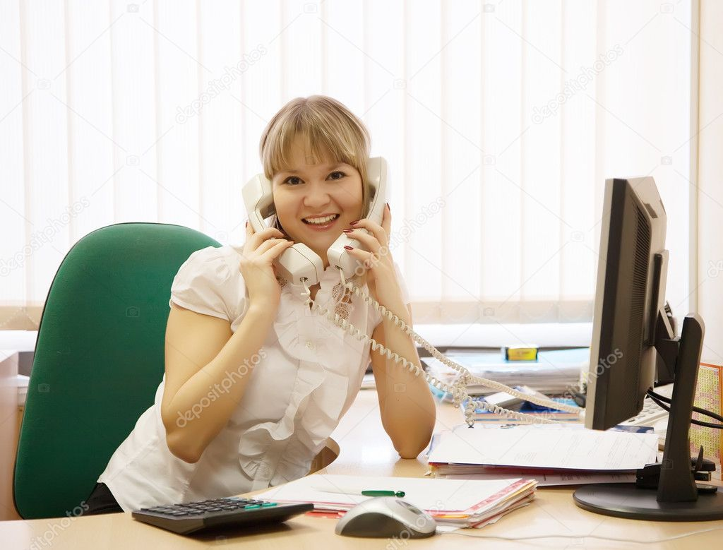 Female  manager speaking by two phone in office — Stock Photo #12502869