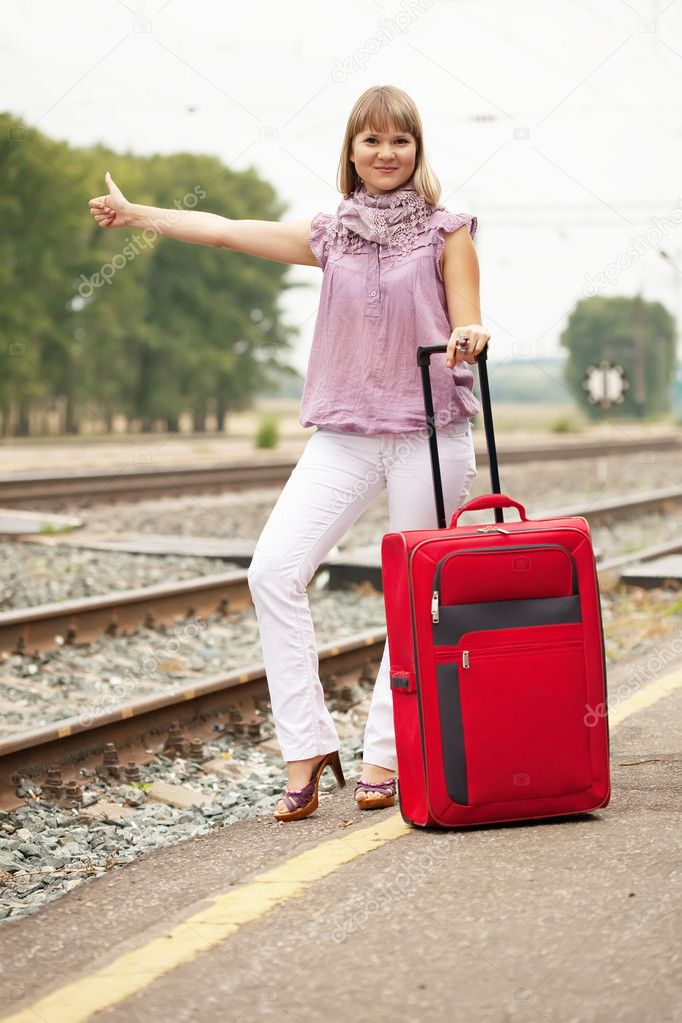 Woman with luggage waiting  train on  railroad — Stock Photo #12502976