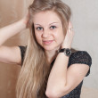 Long-haired blonde girl — Stockfoto
