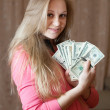 Happy woman with bundles of US dollars — Stock Photo #12510060