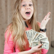 Happy  woman shows bundles of US dollars — Stock Photo