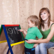 Stock Photo: Mother teaches child