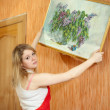Womhangs picture on wall — Stockfoto #12510932