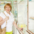 Mature woman buys drugs — Stock Photo #12511331