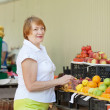 Stock Photo: Woman chooses fruits at market