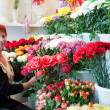 Stock Photo: Woman in flower shop