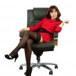 Stock Photo: Sexy woman sitting on office armchair