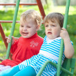 Two children on swings — Stock Photo #12516885