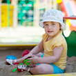 Two-year child playing in sandbox — Stock Photo #12517125