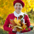 Mature woman  in autumn park - Stock Photo