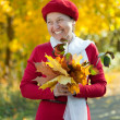 Laughing mature woman  in autumn - Stock Photo