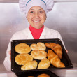 Baker with  pastries - Stock Photo