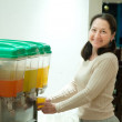 Woman pours a juice — Stock Photo
