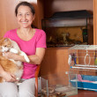 Happy woman with  pets - Stock Photo