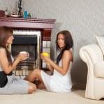 Women near the fireplace — Stock Photo