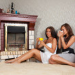 Women near the fireplace — Stock Photo