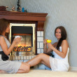 Stock Photo: Women near electric fire