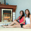 Women near the fireplace - Stock Photo