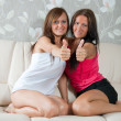Stock Photo: Women showing thumb up
