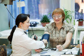 Woman doctor examining the patient — Stock Photo